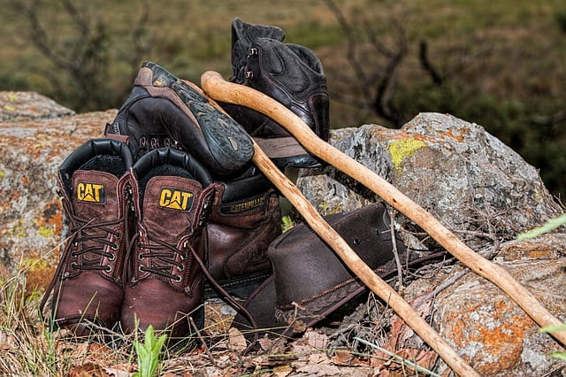 boots and a walking stick