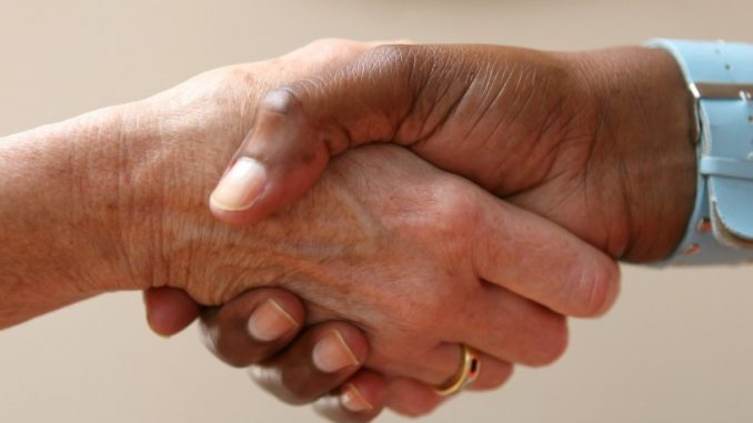 shaking hands after a barter