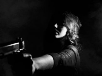 woman with a handgun