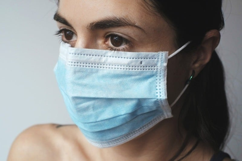 quarantined woman wearing surgical mask