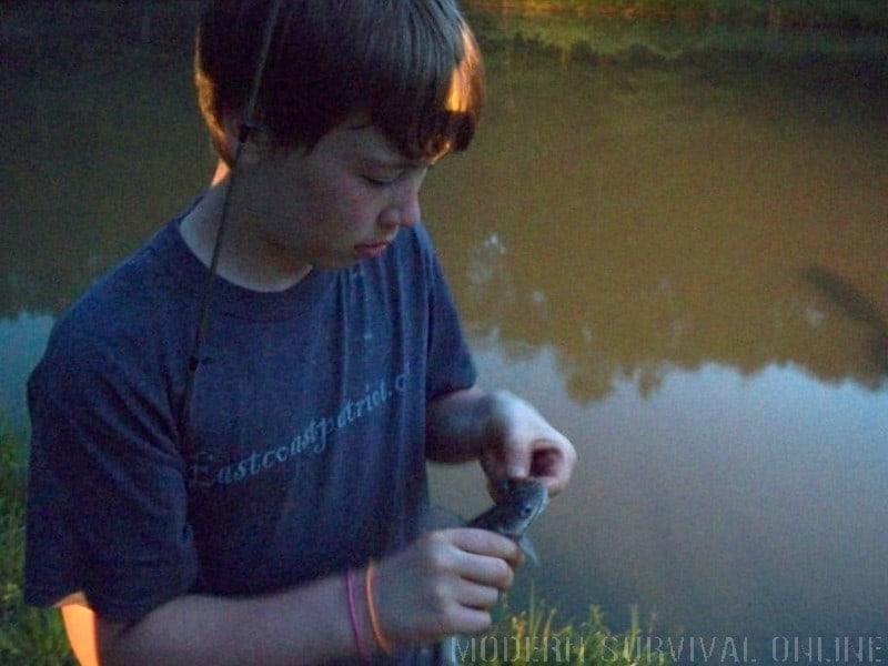 boy catches a fish update