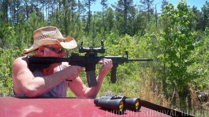 man firing an AR