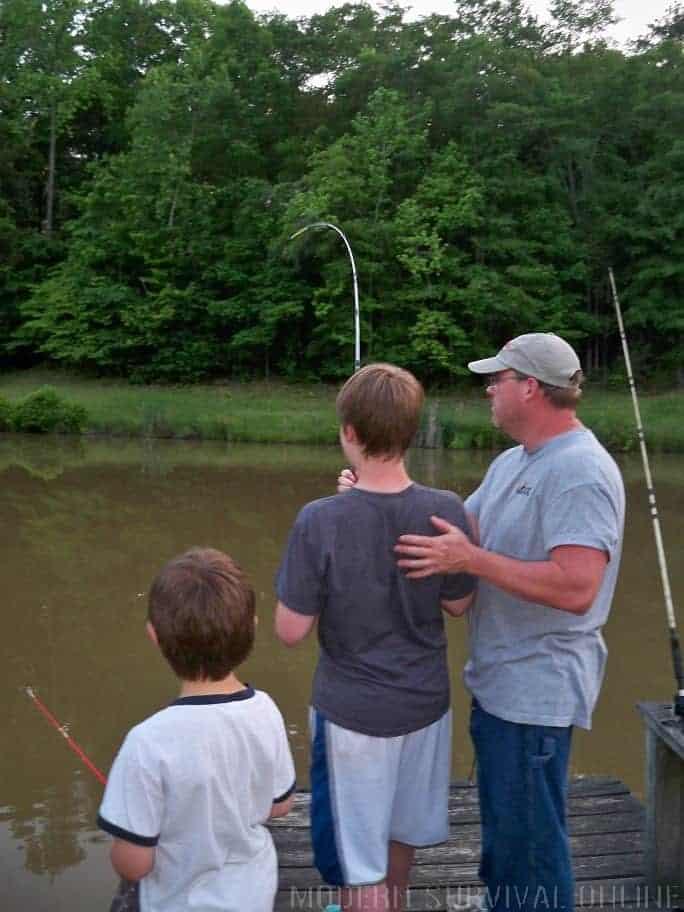 man fishing with children