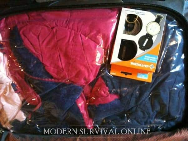 clothes in vacuum pack and map and compass in backpack