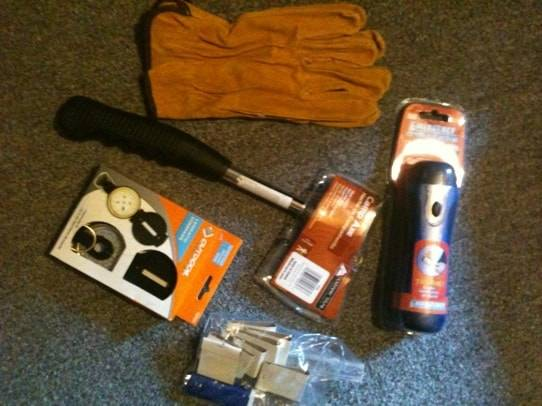 hatchet map compass gloves flashlight